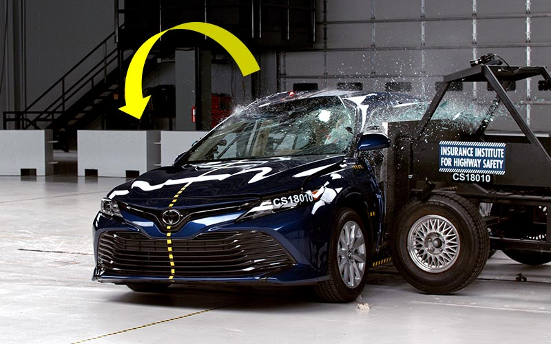 Current IIHS movable barrier causing test vehicle to roll away from impact