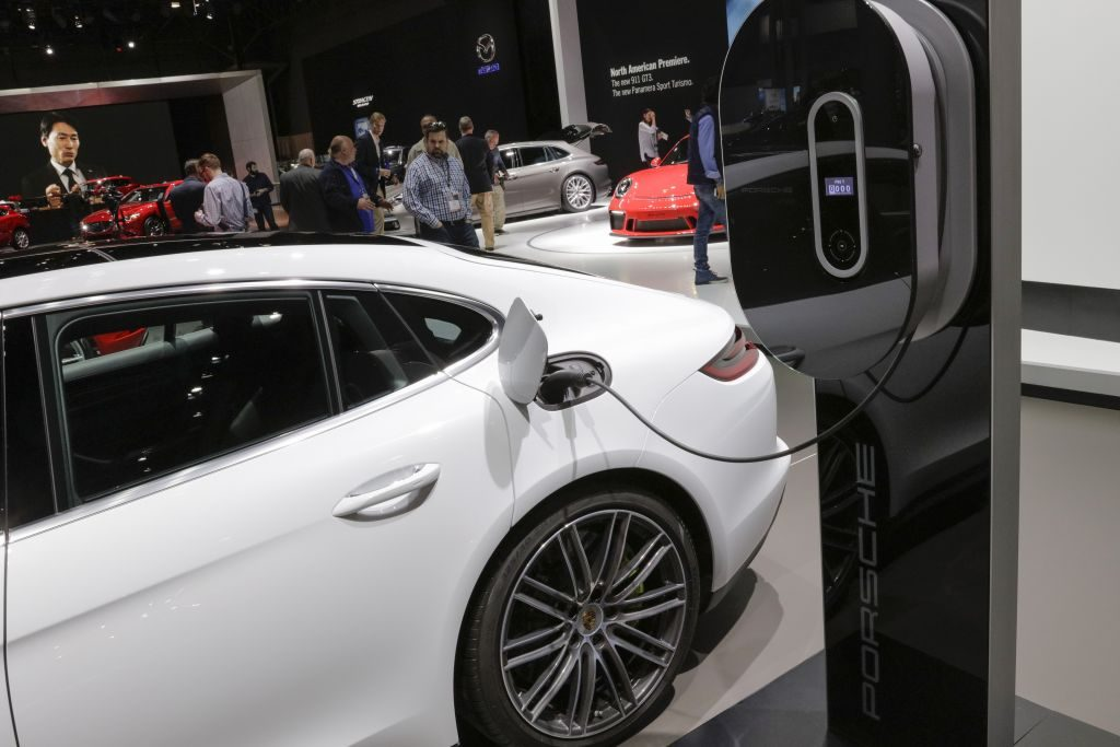 A concept electric vehicle from automaker Porsche is plugged in and charging at the 2017 New York International Auto Show