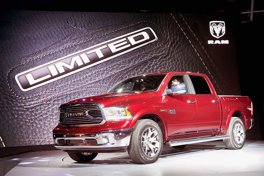 The Ram 1500 Laramie Limited pickup truck on display in red