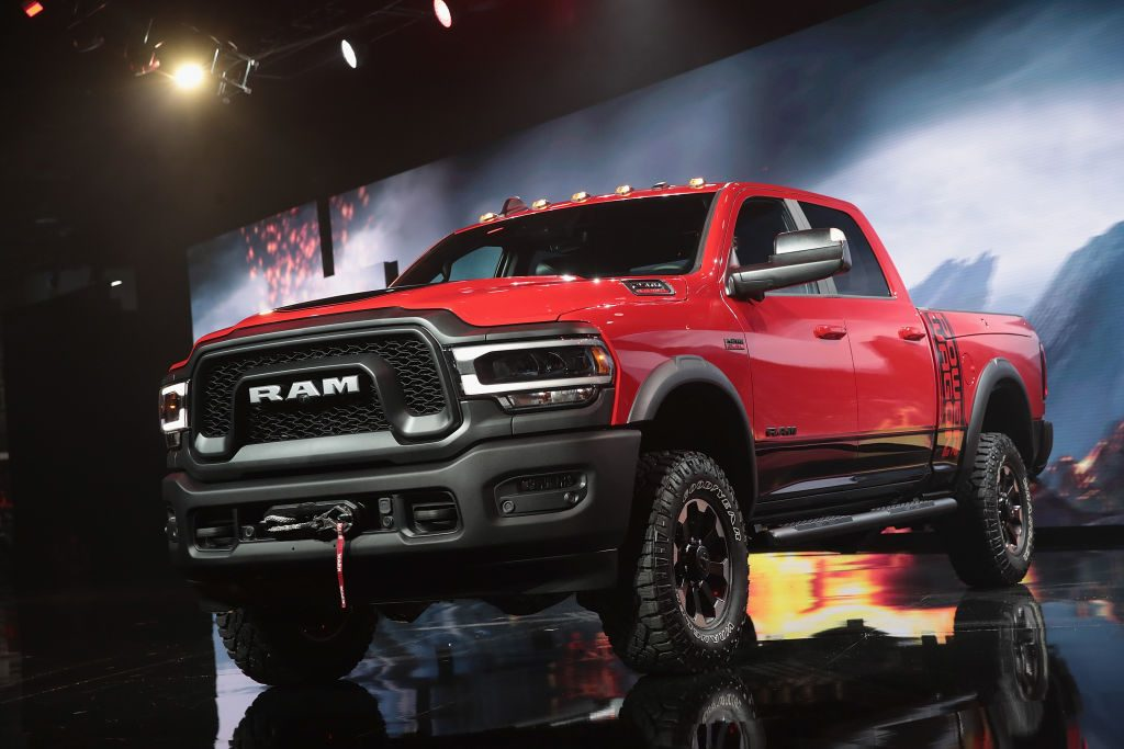 A red Ram pickup truck on display at an auto show.