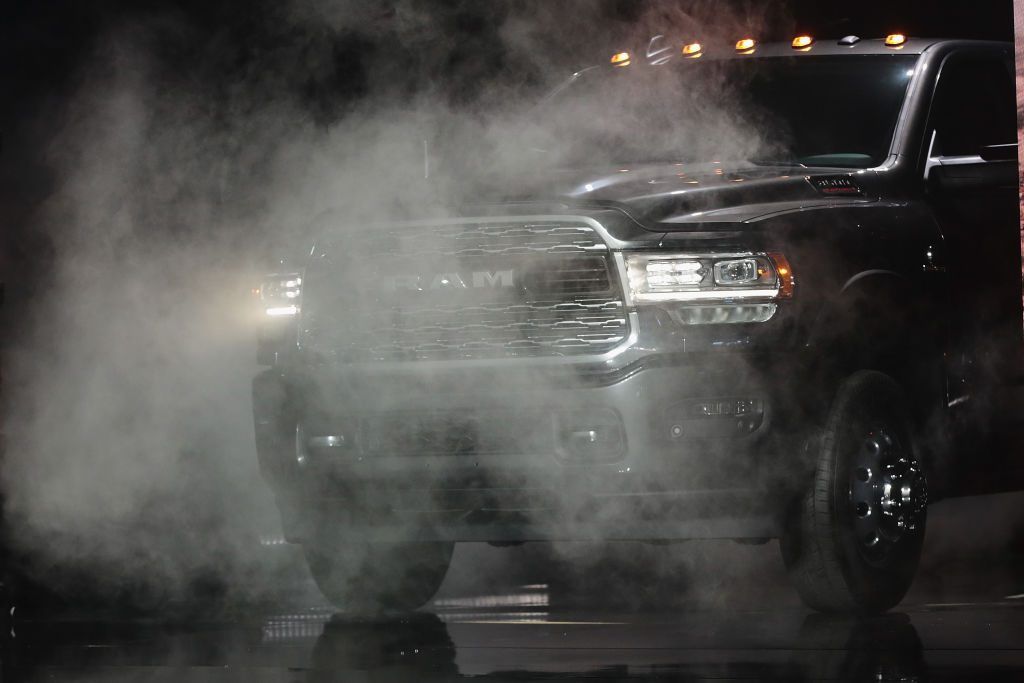 A heavy duty Ram 3500 diesel is debuted during an auto show.