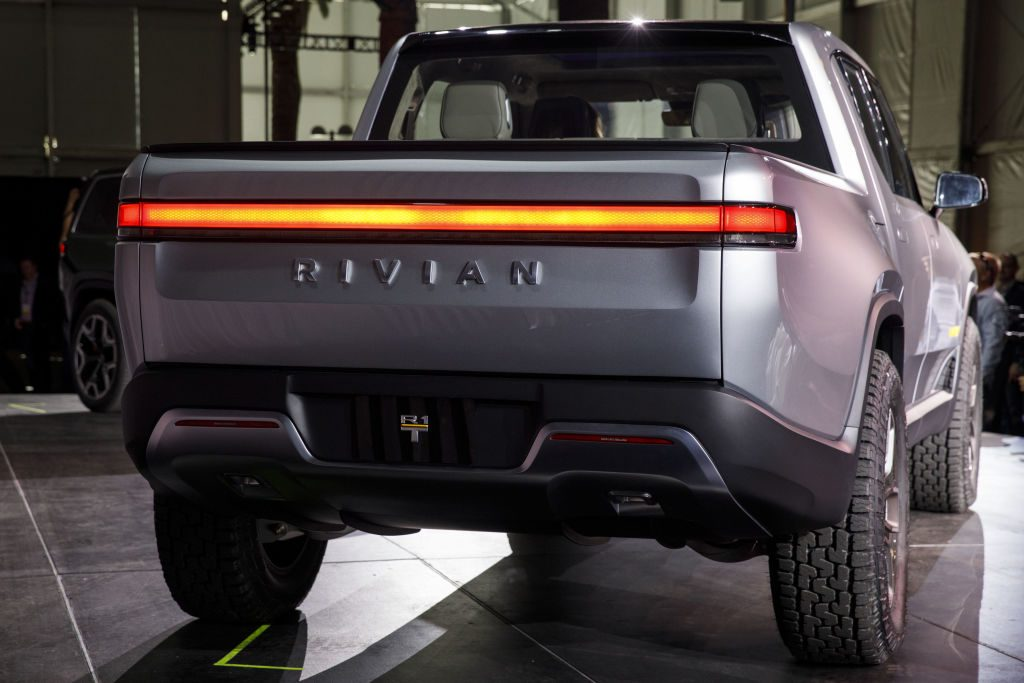 A Rivian R1T on display during an auto show.