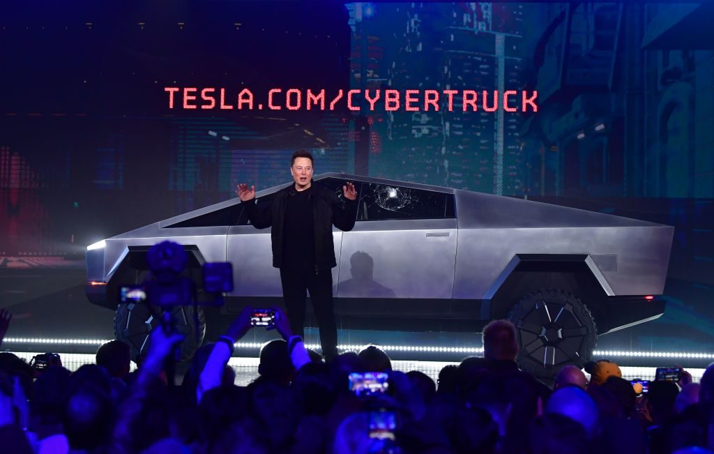 Tesla co-founder and CEO Elon Musk speaks in front of the newly unveiled all-electric battery-powered Tesla's Cybertruck