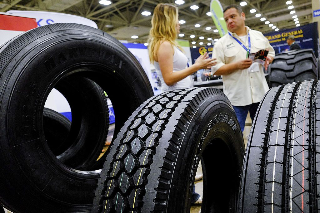 Truck tires sit on display during a car and truck show