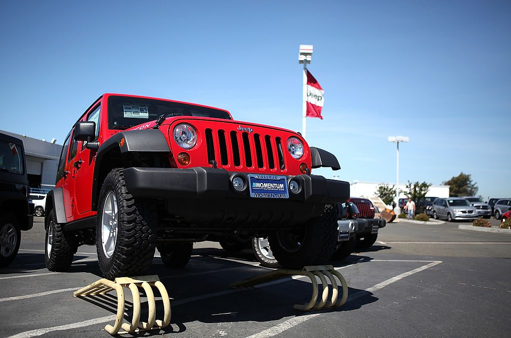 A used Jeep Wrangler for sale at a car dealership.