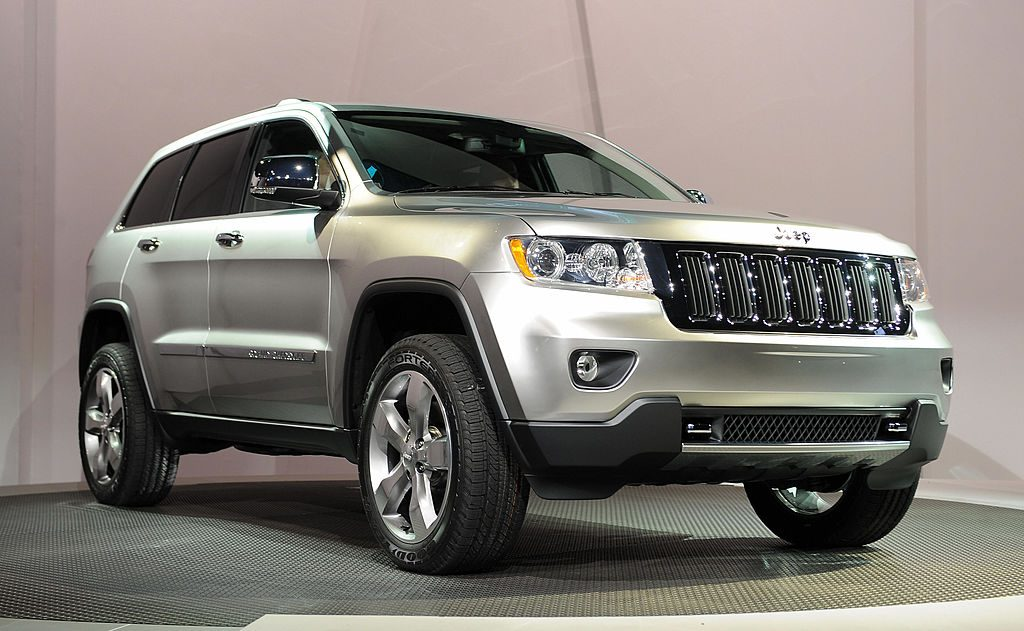 A 2011 Jeep Grand Cherokee on display at an auto show.