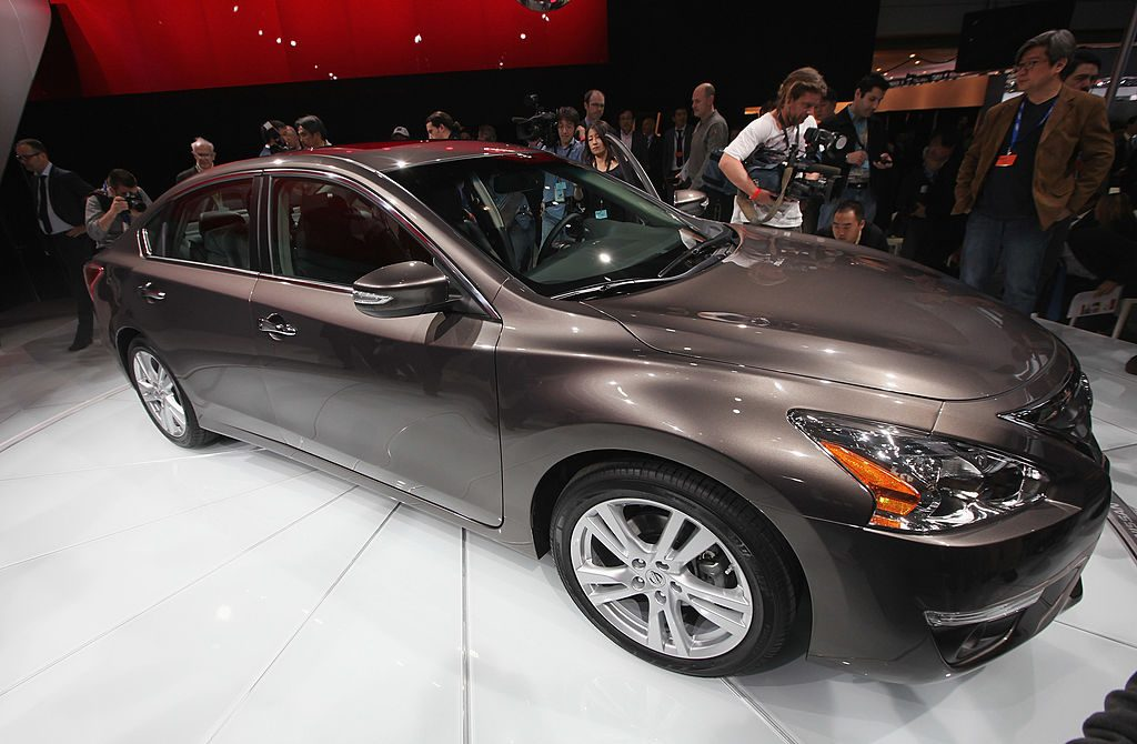 A 2013 Nissan Altima on display at an auto show.