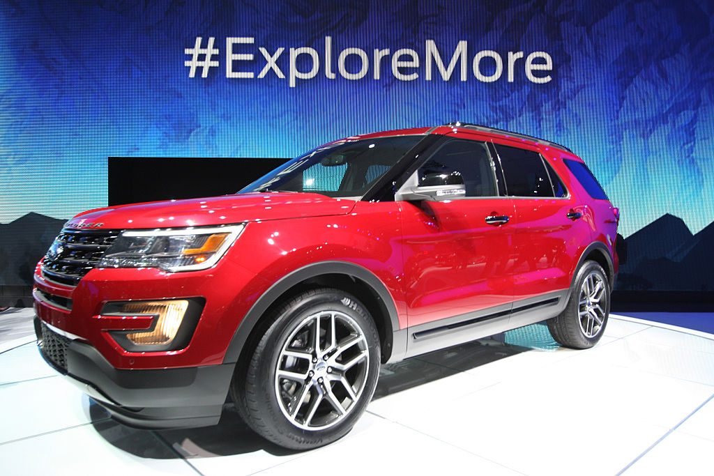 A red 2016 Ford Explorer on display at an auto show