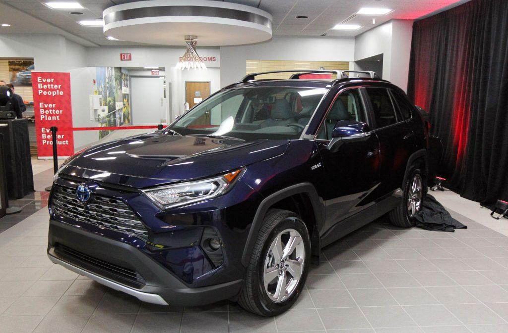 A 2019 Toyota RAV4 on display at a car dealership