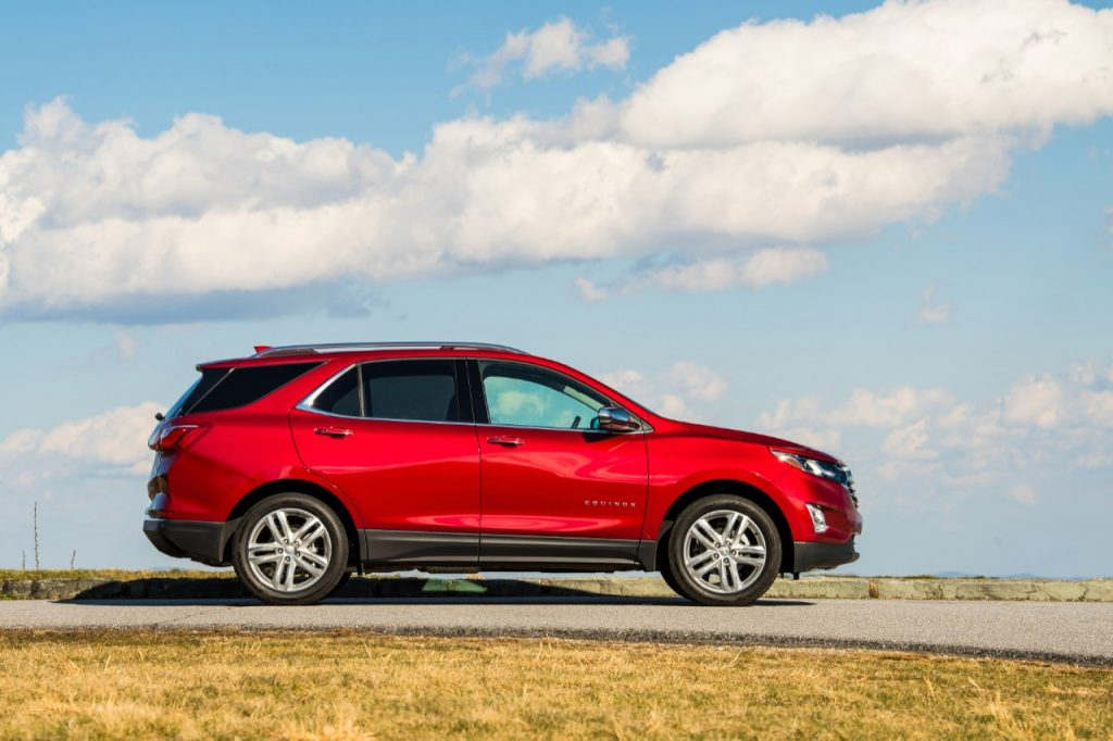 The 2020 Chevrolet Equinox drives along a road