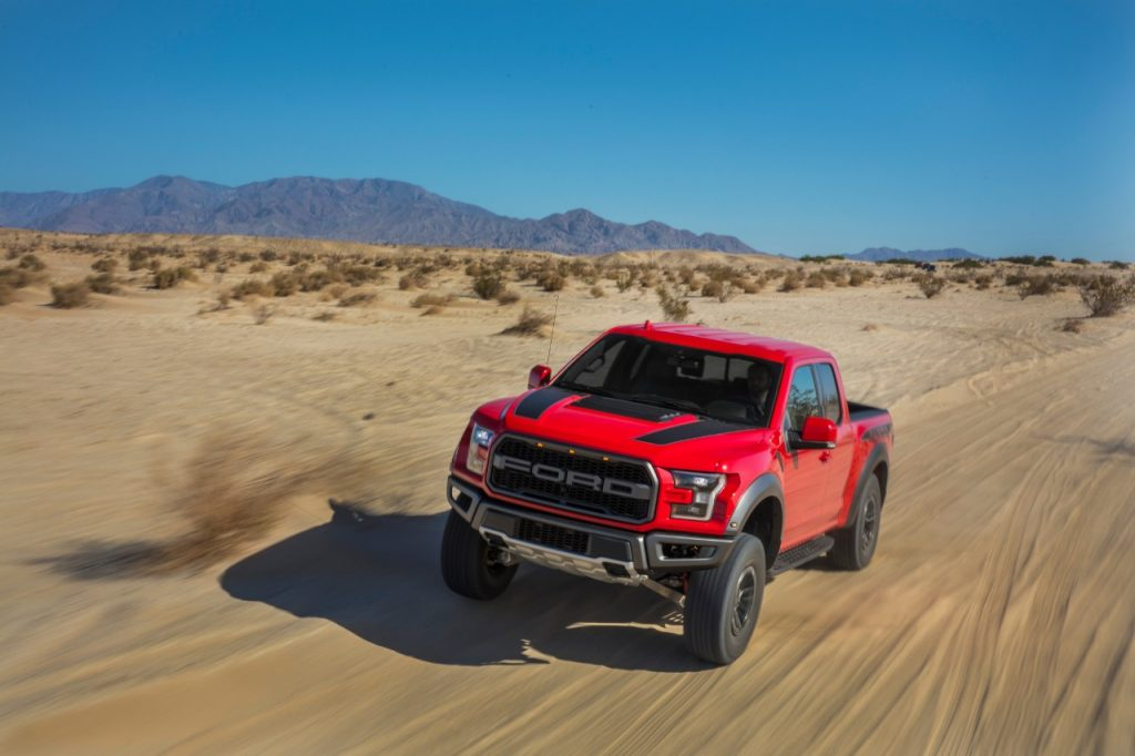 The 2020 Ford F-150 races down a sandy road