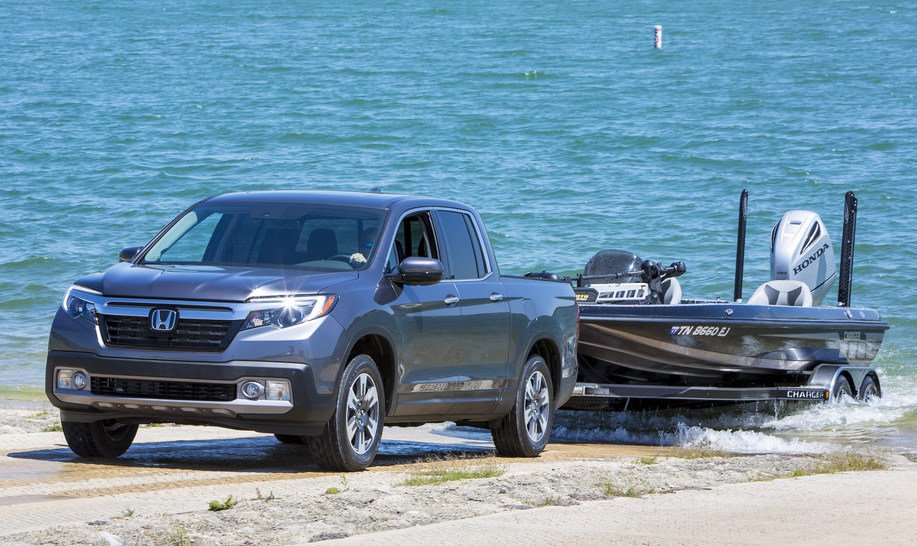 2020 Honda Ridgeline towing a boat through sand