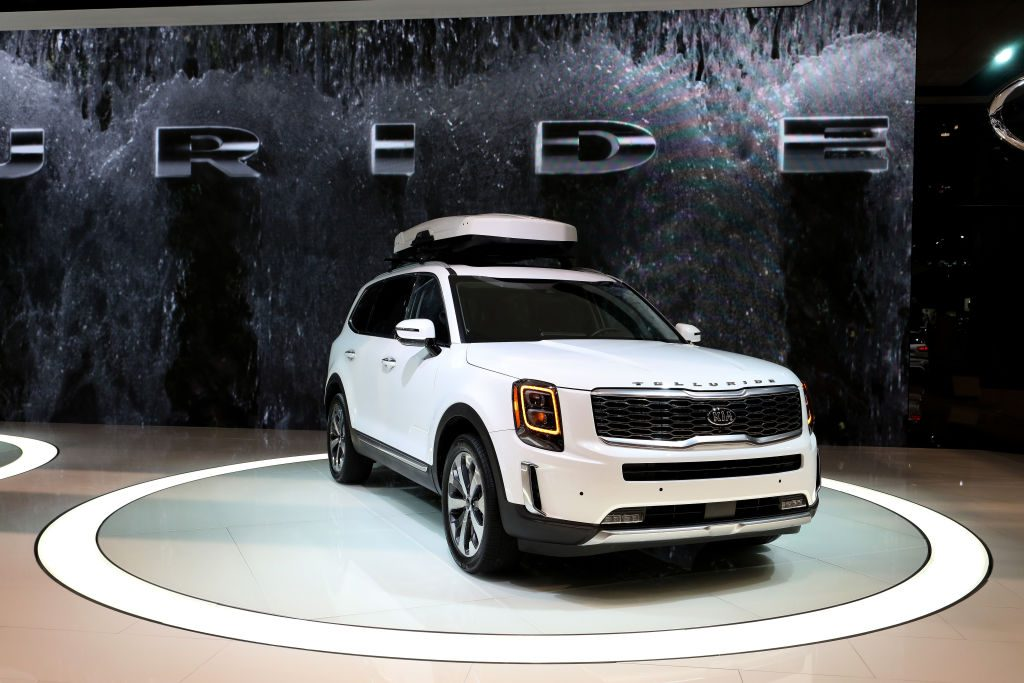 Kia's 3 row SUV, the Telluride on display at an auto show.