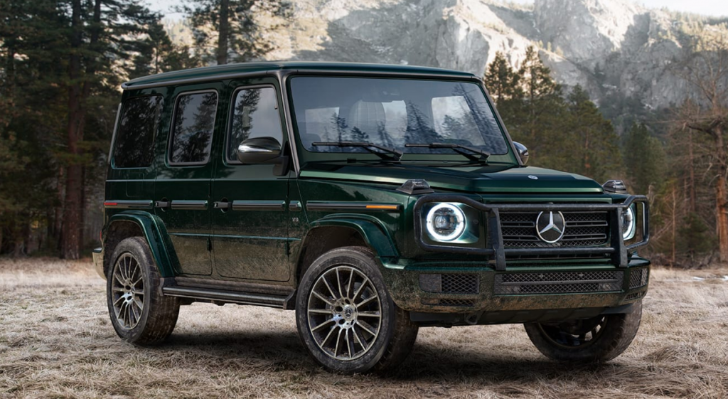 a green 2020 Mercedes G-Class 4x4 off-road SUV in the mountains
