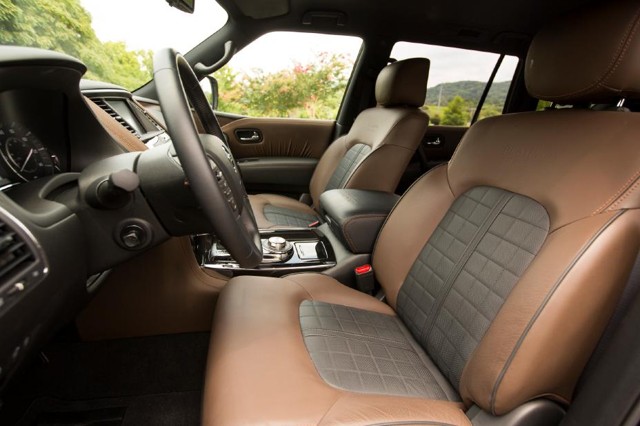 the front row interior of a 2020 Nissan Armada with brown leather