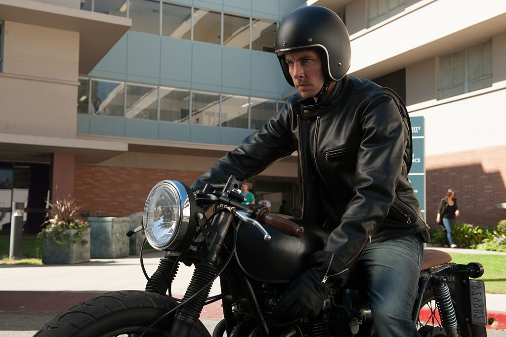 Dax Shepard sitting on a motorcycle ready to ride
