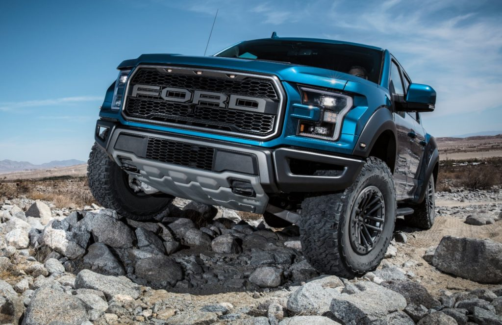 Ford F-150 Raptor climbing over rocks