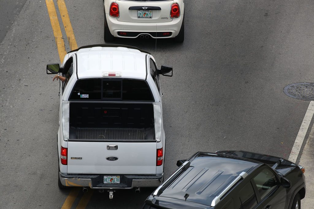 A Ford F-150 is stuck in traffic.