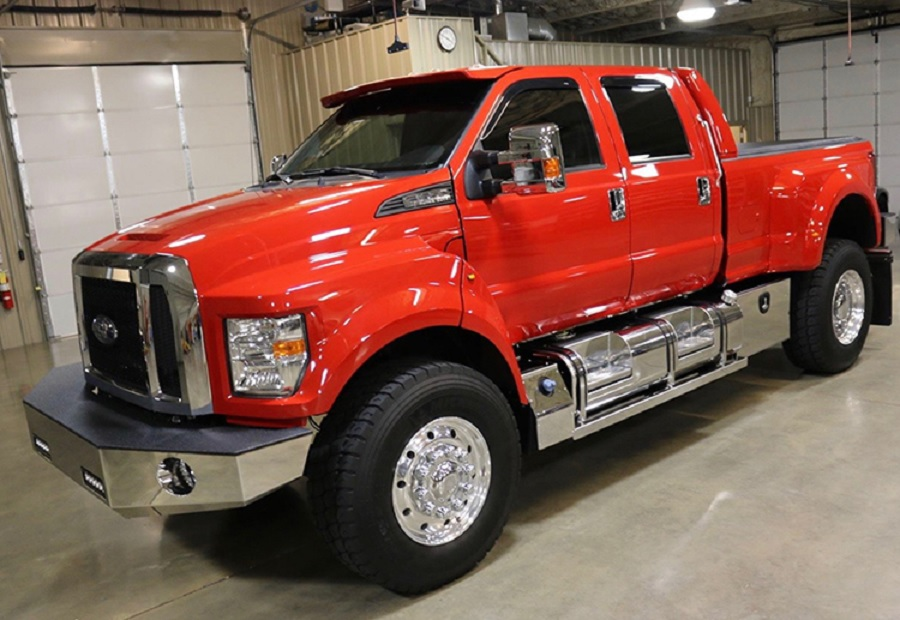 A red Ford F-650 SuperTruck side