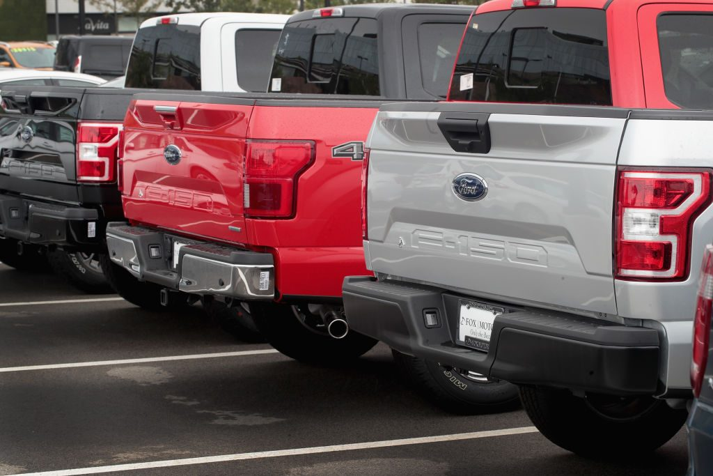 Ford F-150 full-size trucks on a sales lot.