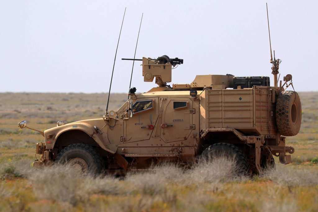 A JLTV U.S. military truck driving in the desert.