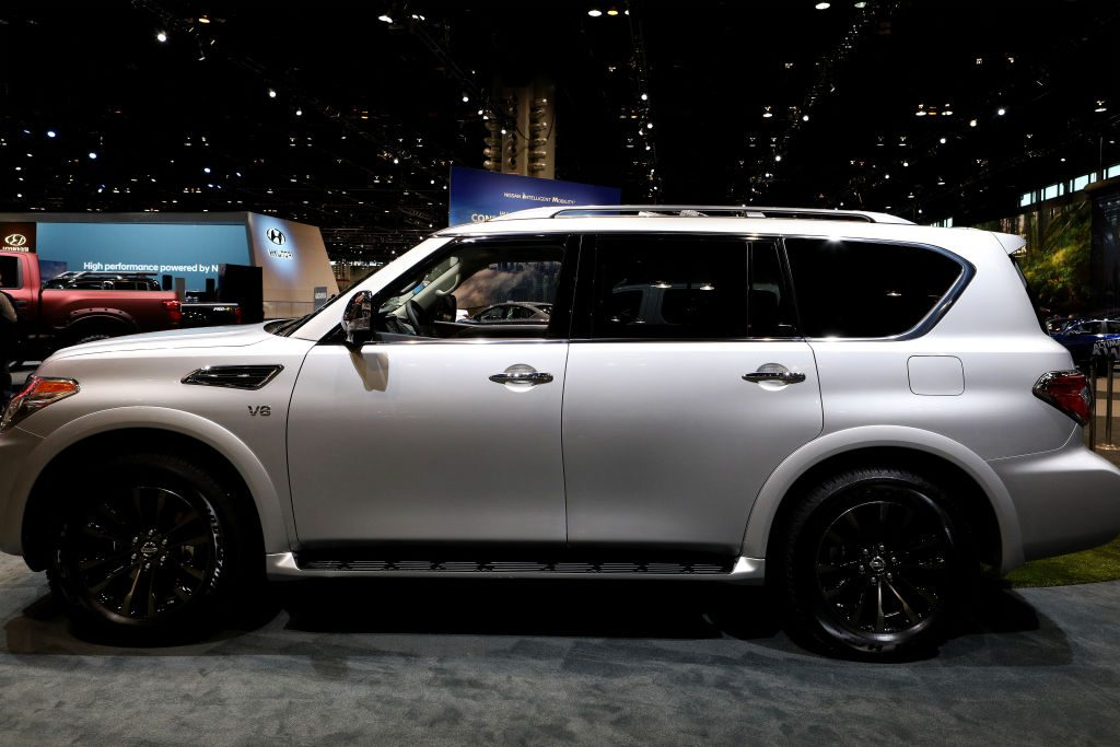 A Nissan Armada SUV on display at an auto show.