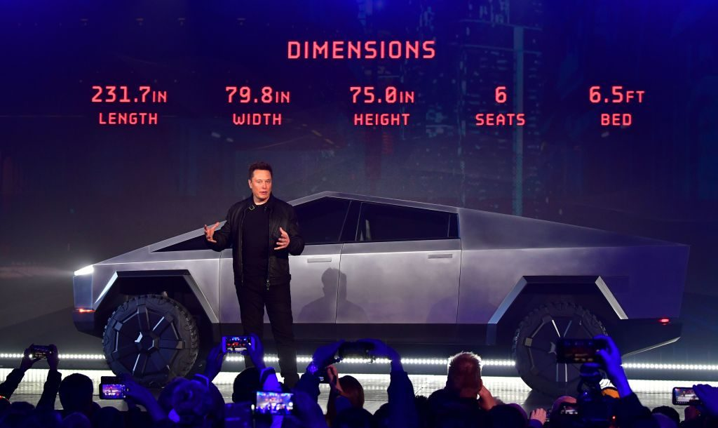 Elon Musk discusses vehicle dimensions at the unveiling of the new Tesla Cybertruck.