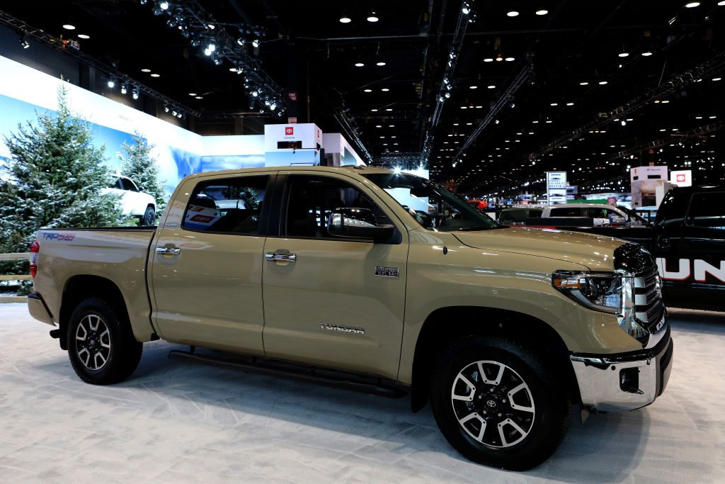 A new Toyota Tundra on display at an auto show. These capable trucks are known for dependability.