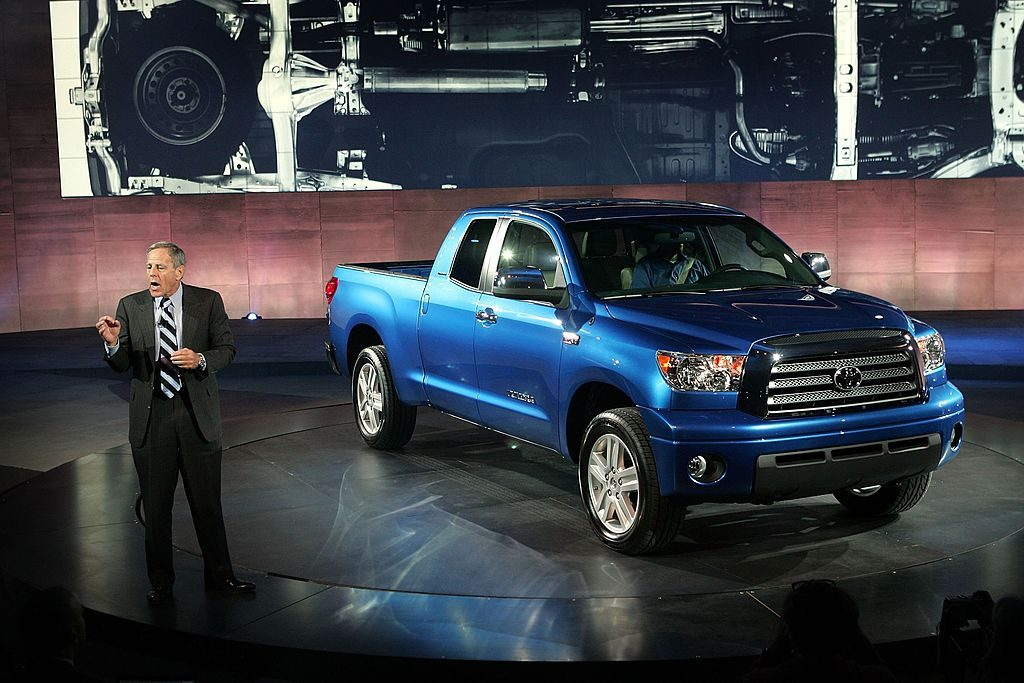 A Toyota Tundra being unveiled at an auto show.