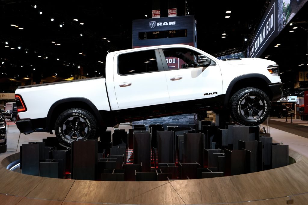 A white Ram 1500 on display at an auto show.