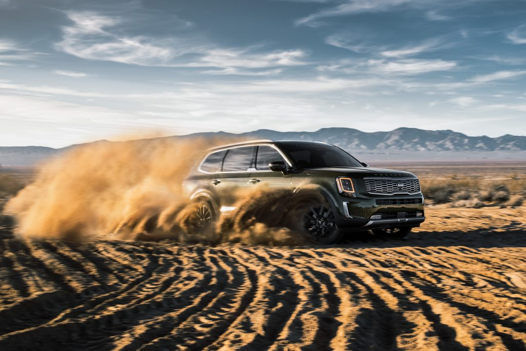 2020 Kia Telluride driving through sand