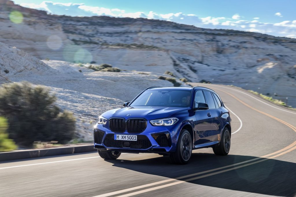 2020 BMW X5 M driving up mountain road