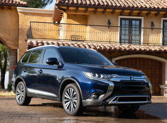 2020 Mitsubishi Outlander PHEV parked in front of home