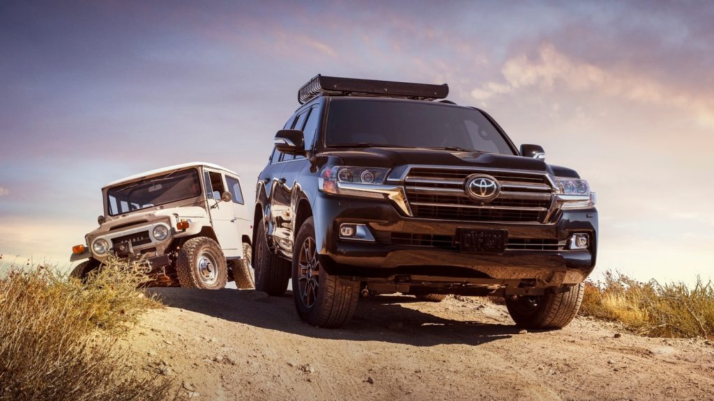 2020 Toyota Land Cruiser Heritage Edition with FJ40 off-roading in desert