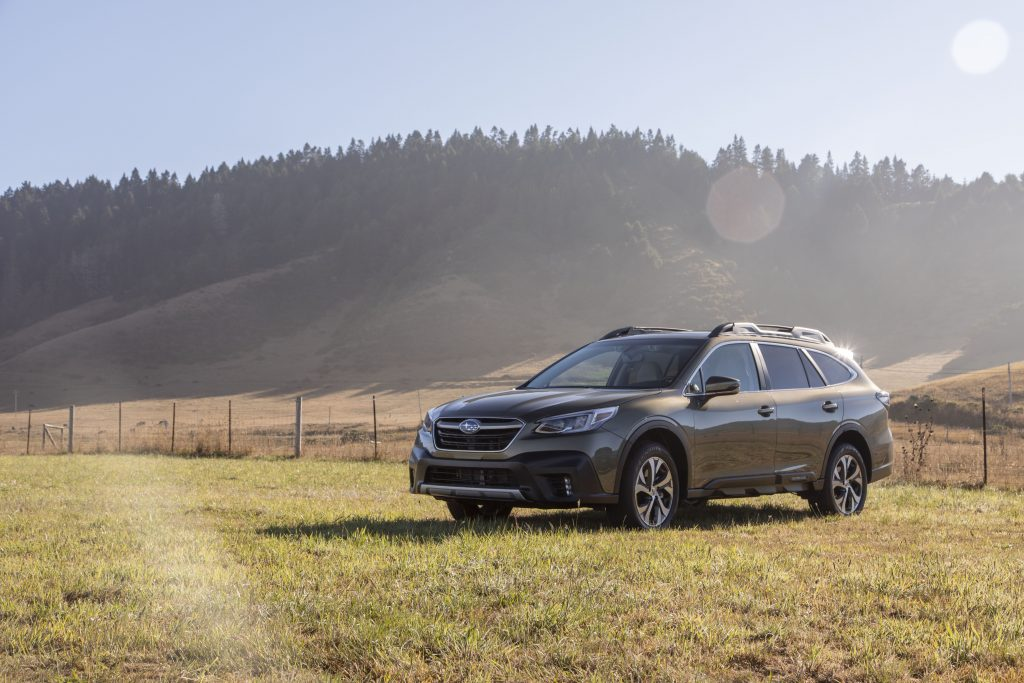 2020 Subaru Outback AWD SUV parked in a green field