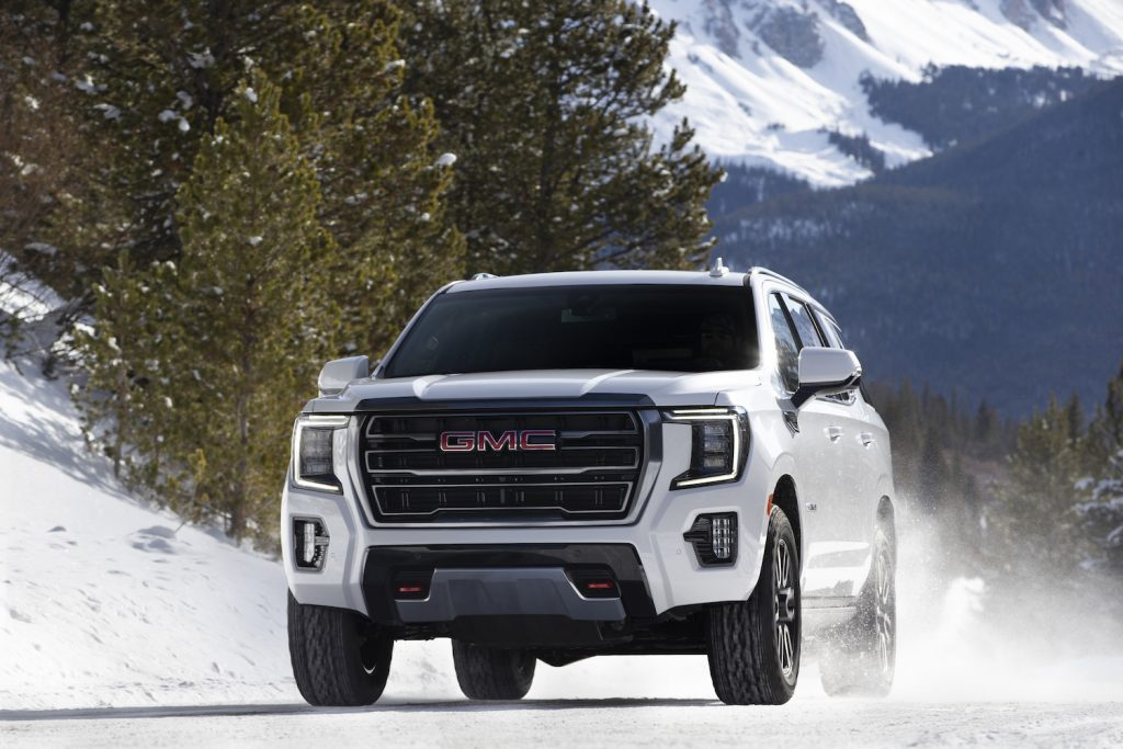 2021 GMC Yukon AT4 driving down icy road