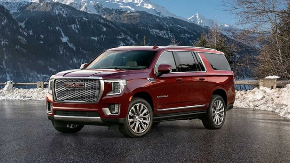 2021 GMC Yukon XL Denali parked on snowy mountain top