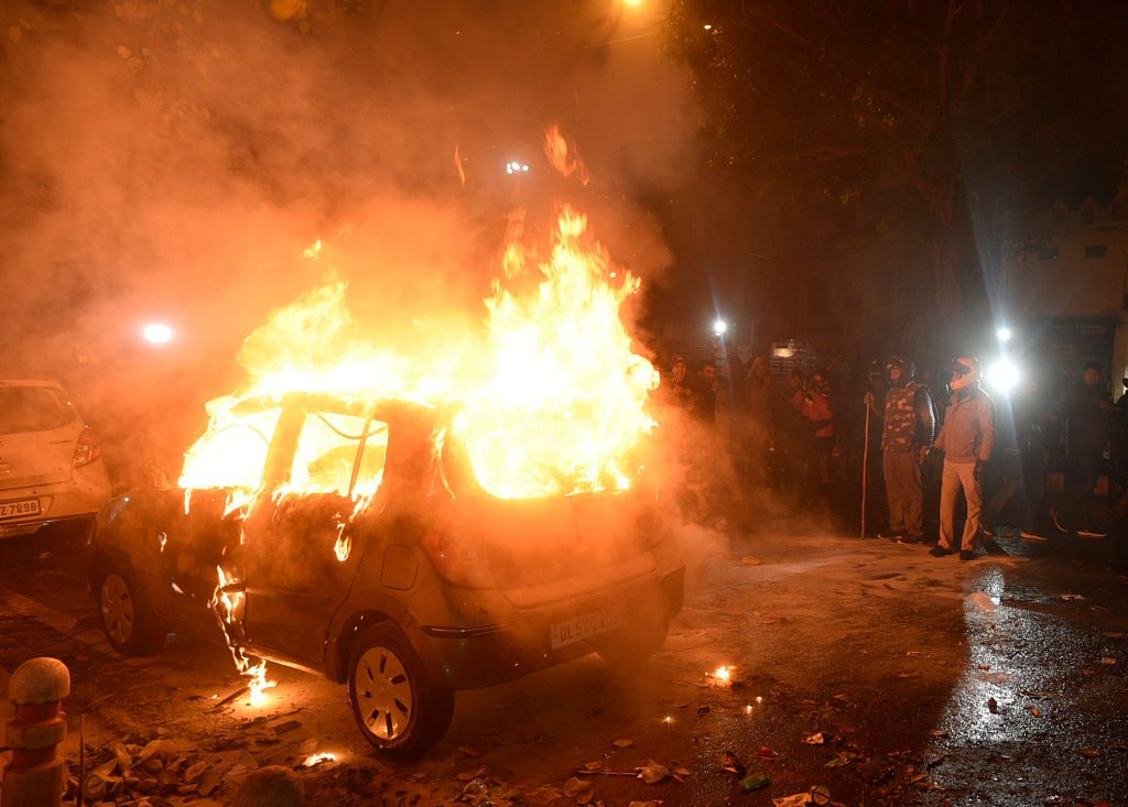 A car on fire in New Delhi, India