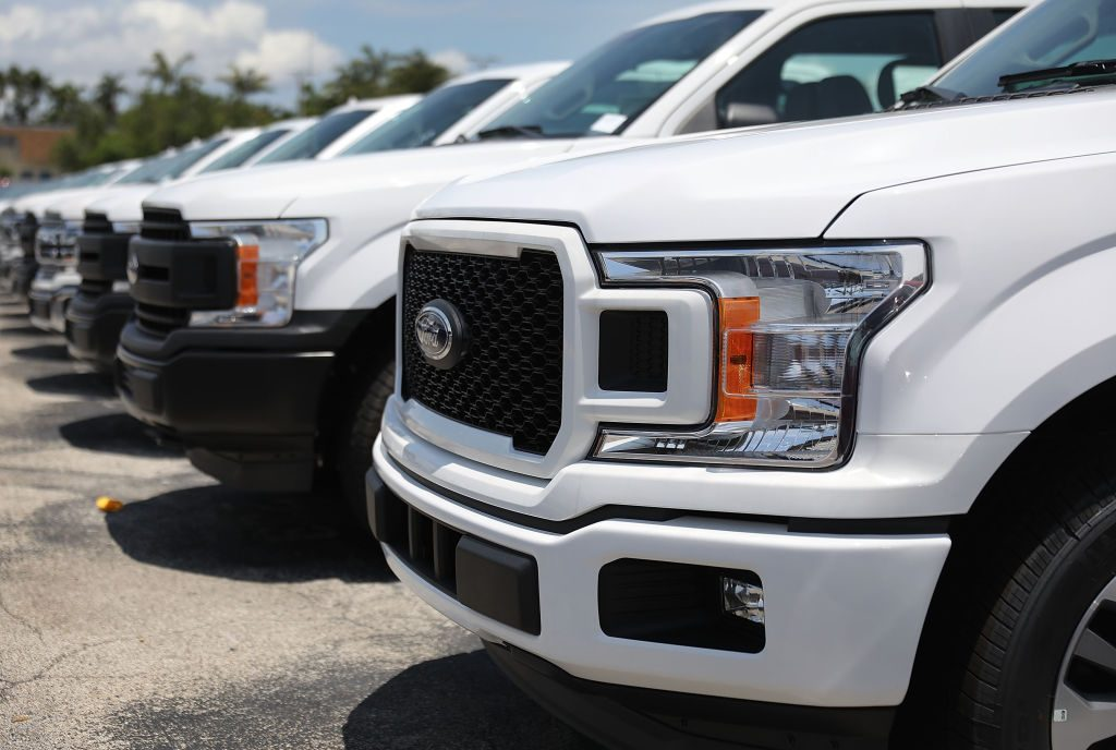 Ford F-150 trucks for sale at a dealership in Miami