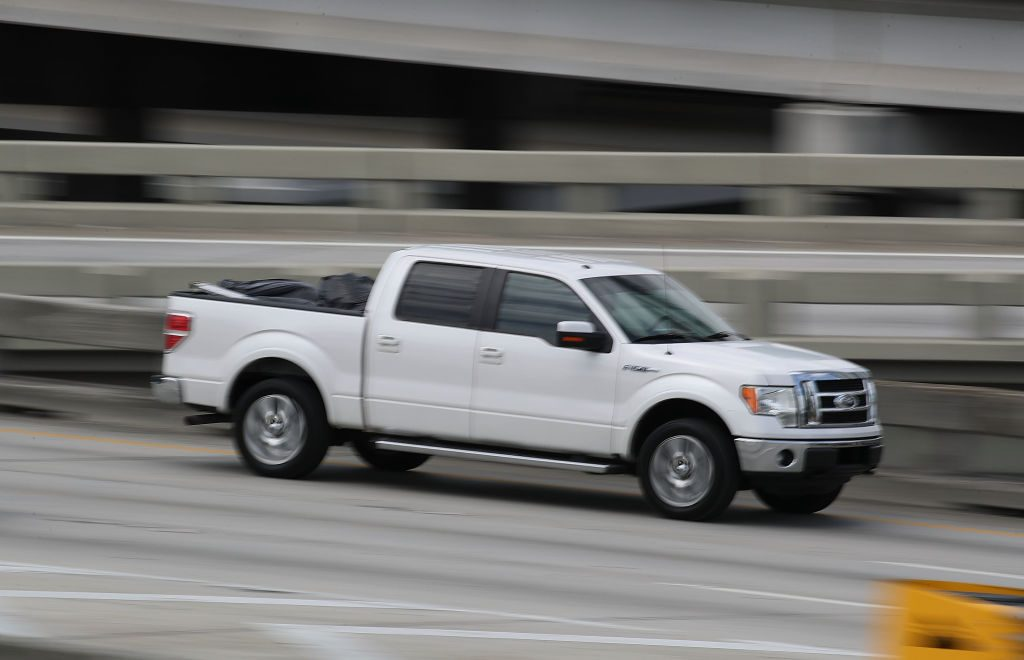 Ford pickup truck drives on a road in Miami