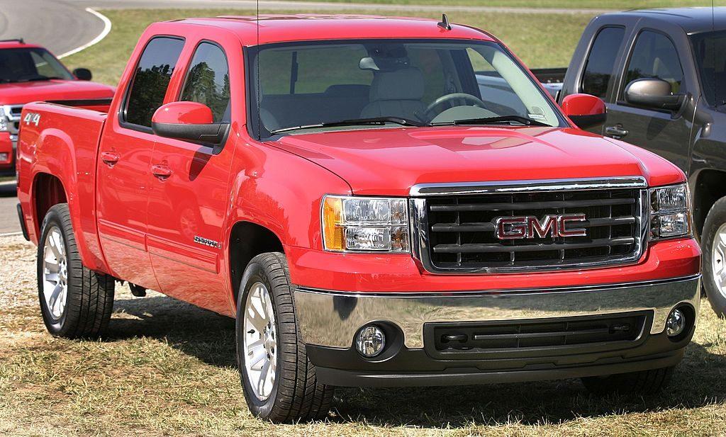 A GMC Sierra truck parked on some grass