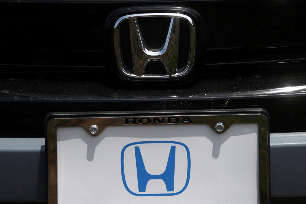 The Honda logo on a new car