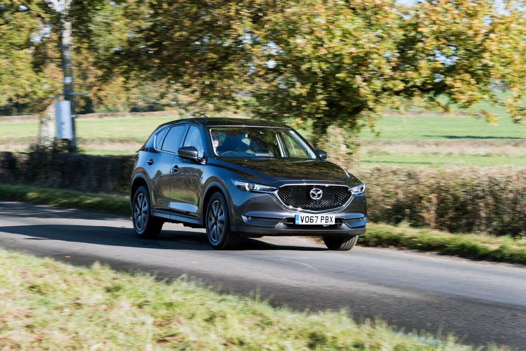 A Mazda CX-5 driving down the road