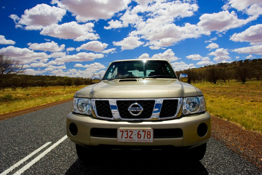A 4WD Nissan Patrol driving down the highway in Australia