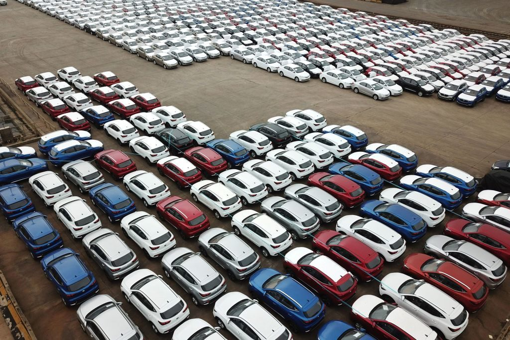 A car lot filled with cars produced in China