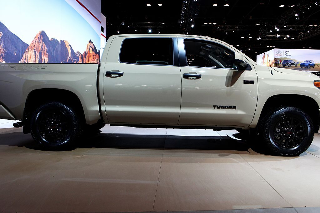 A white Toyota Tundra on display during an auto show