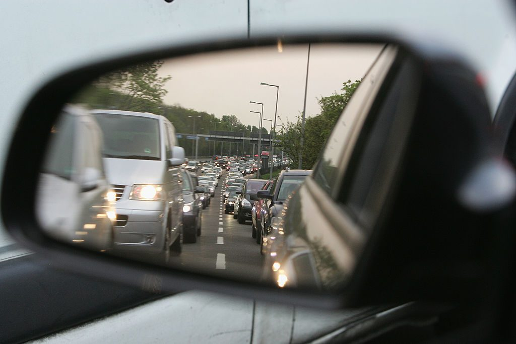 A traffic jam seen from a rear-view mirror