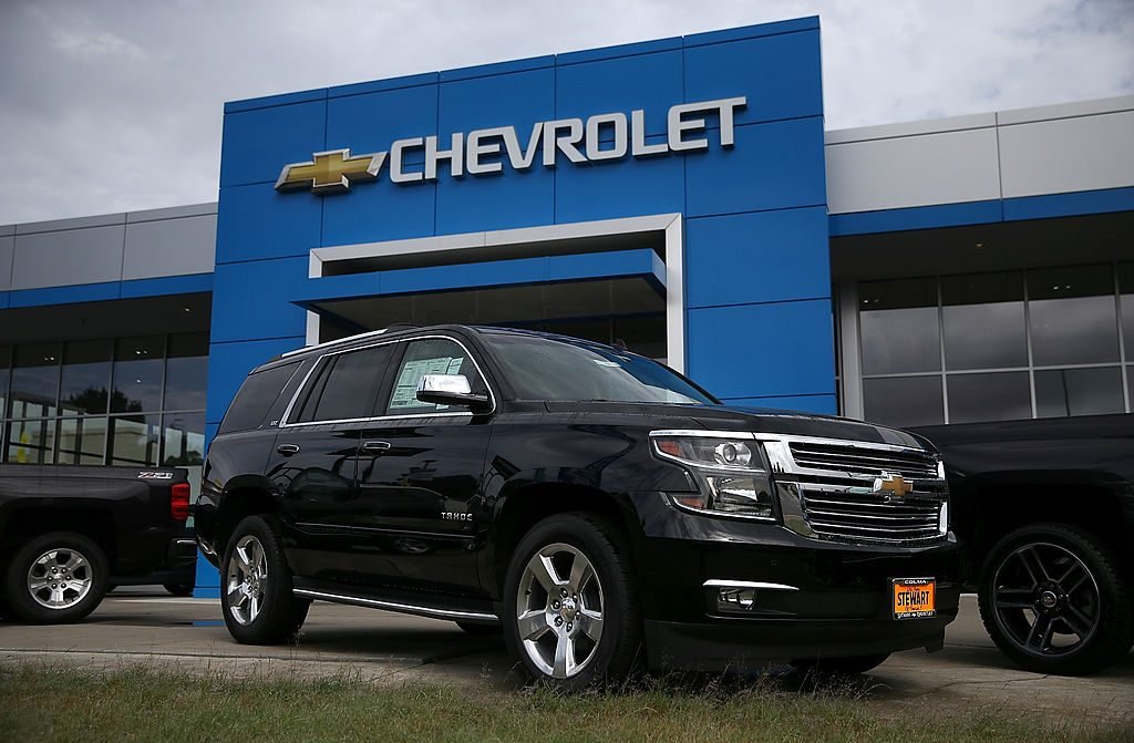 A Chevy Tahoe for sale outside of a car dealership