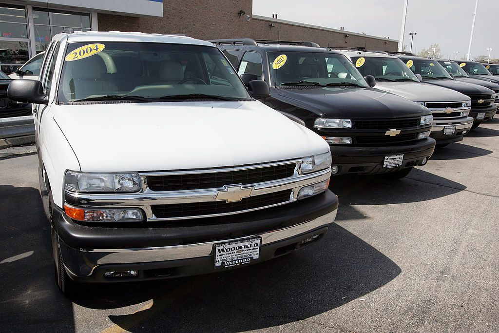 A car dealership offering used Chevy Tahoes