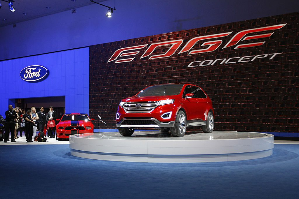 People watch a presentation of the Ford Edge concept vehicle during media preview days at the 2013 Los Angeles Auto Show on November 20, 2013